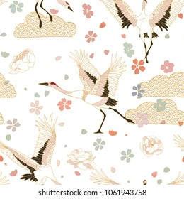 Japanese pattern. Seamless vector ornament with traditional motives. Japanese pattern with storks and sakura.
