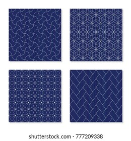 Japanese sashiko ornaments. Set. Asian embroidery motifs. Abstract Seamless patterns. Four simple textures. White stitches on the indigo blue background. For handicraft or decoration.