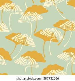 a  japanese style ginkgo biloba leaves seamless tile in a gold and light blue color palette