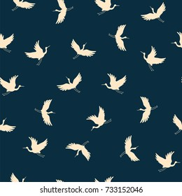 Japanese traditional seamless vector doodle pattern with flying birds cranes silhouette.