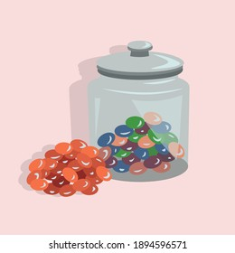 Jar of Colorful Jelly Beans Isolated on Pink