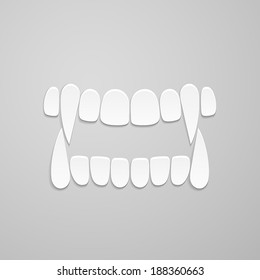 jaw with canines on grey background