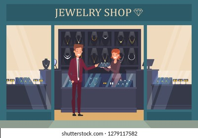 Jewelry shop showcase with man choosing ring