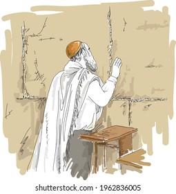 Jewish man wearing a tallit praying at the sacred Wailing Wall, Western Wall. Jerusalem. Israel.