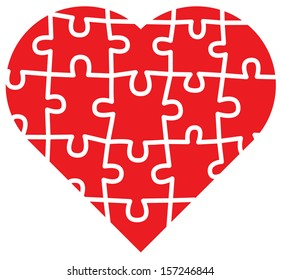 Jigsaw puzzle with all its pieces put together forming a big red heart of love
