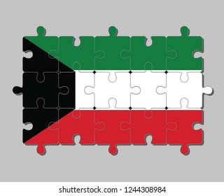 Jigsaw puzzle of Kuwait flag in green white and red color with black trapezium based on the hoist side. Concept of Fulfillment or perfection.
