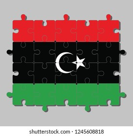Jigsaw puzzle of Libya flag in red black and green with a white crescent and star. Concept of Fulfillment or perfection.