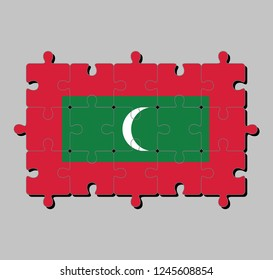 Jigsaw puzzle of Maldives flag in green with red border and white crescent on center. Concept of Fulfillment or perfection.