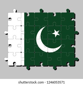 Jigsaw puzzle of Pakistan flag in  a white star and crescent on a dark green field, with a vertical white stripe. Concept of Fulfillment or perfection.