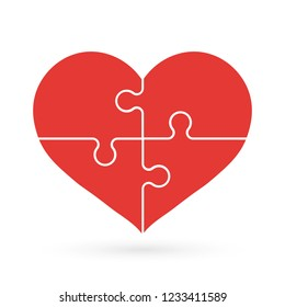 Jigsaw puzzle pieces in form of red heart. The heart of the puzzle