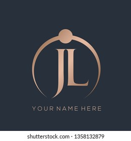 JL monogram in a ring shape.Typographic logo with serif letter j and letter l.Uppercase lettering icon in rose gold color isolated on dark background.Stylish wedding initials.Modern, luxury style.