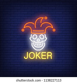 Joker neon sign. Lettering with smiling skull in joker cap. Night bright advertisement. Vector illustration in neon style for gambling, casino and poker club