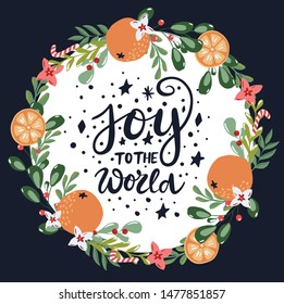 Joy to the world greeting card with hand written calligraphy words and  hand drawn floral branches and design elements in red and green colors on dark background