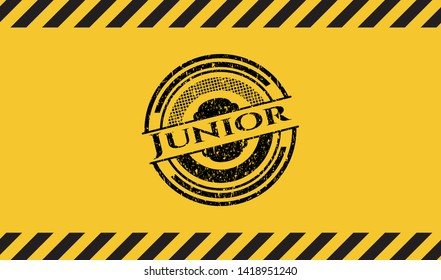 Junior black grunge emblem, yellow warning sign. Vector Illustration. Detailed.