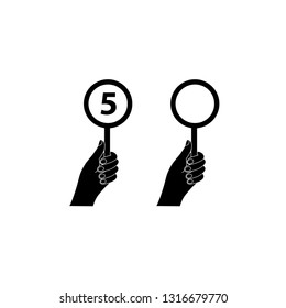 Jury Evaluation Number icon. Judges vote icon hand holding round signs for scores competition, tournament or game.