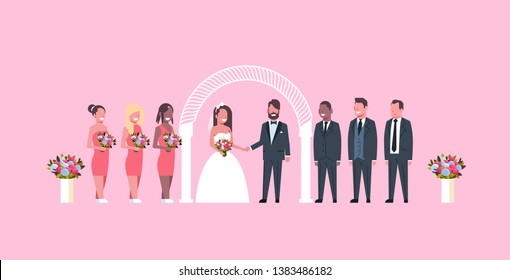 just married bride and groom with bridesmaids groomsmen standing together near arch wedding ceremony concept pink background full length horizontal flat