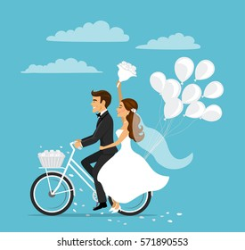 Just married happy couple bride and groom riding bicycle with balloons