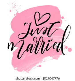 Just Married with heart hand drawn calligraphy inscription on pink paint brush stroke