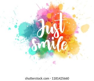 Just smile - handwritten modern calligraphy lettering on colorful watercolor splash