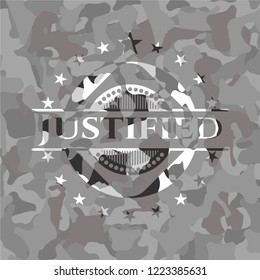 Justified on grey camouflage texture