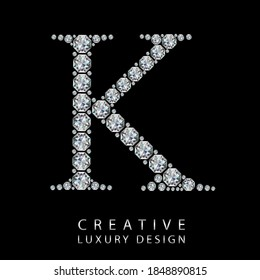 K diamond letter vector illustration. White gem symbol logo for your luxury business, casino, jewelry or web site. Upper letter with many sparkling diamonds isolated on black background.