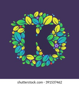 K letter logo in a circle of leaves and flowers. Font style, vector design template elements for your vegan or ecology application or corporate identity.