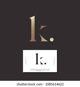 K letter. K monogram. Elegant gold monogram K with dot on a dark background. Original business card.