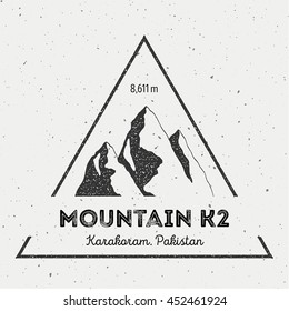 K2 in Karakoram, Pakistan outdoor adventure logo. Triangular mountain vector insignia. Climbing, trekking, hiking, mountaineering and other extreme activities logo template.