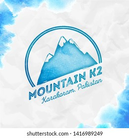 K2 logo. Round mountain turquoise vector insignia. K2 in Karakoram, Pakistan outdoor adventure illustration. Climbing, trekking, hiking, mountaineering and other extreme activities logo template.
