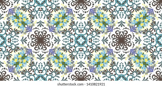 Kaleidoscope seamless pattern. Composed of color abstract shapes and floweras. Useful as design element for texture and artistic compositions.