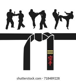 Karate belt, men demonstrating karate. A hieroglyph on the belt - Karate (Japanese)