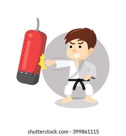 Karate boy punching sand sack