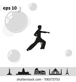 Karate kick silhouette.