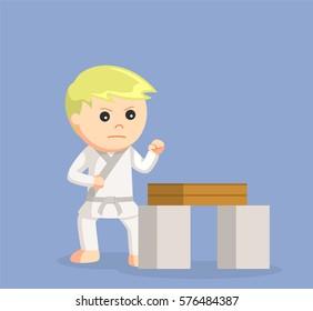 karate kid doing breaking boards technique