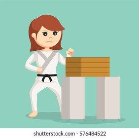 karate woman doing breaking boards technique