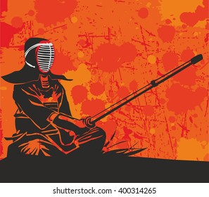 Kendo master is sitting on a hill and holds a bamboo sword