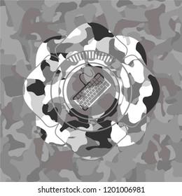 keyboard icon on grey camouflaged pattern