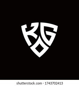 KG monogram logo with modern shield style design template isolated on black background