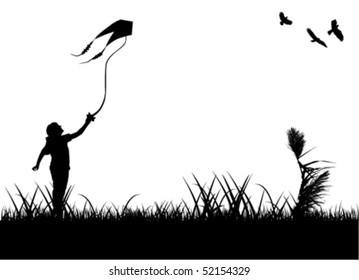 kid flying kite