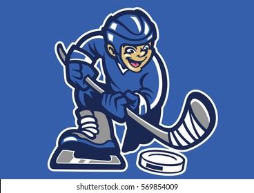 kid playing hockey ice