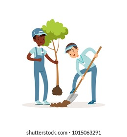 Kids planting tree. Boys in overalls and caps. One kid holding seedling in his hand, other digging pit with shovel. Gardening concept. Cartoon volunteers. Flat vector
