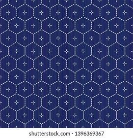 Kimono pattern. Sashiko. Abstract hexagon seamless texture. Japanese embroidery ornament. White stitches on the indigo blue background. For decoration, pattern fills for printing on fabric.