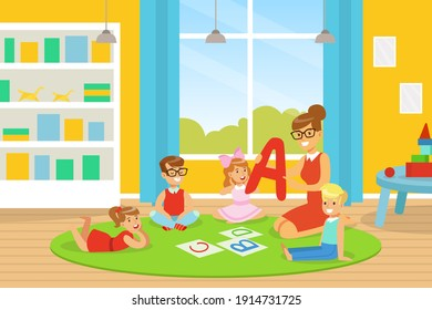 Kindergarten Teacher Explaining Alphabet to Kids, Cute Boys and Girls Learning on Floor and Learning in Kindergarten or School Vector Illustration