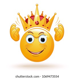 King emoticon wears a crown. Smiley king. Positive smiling ball in the crown. King expression. King emoji. Cheerful monarch in the crown. Vector illustration