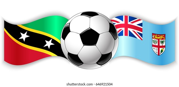 Kittitian and Fijian wavy flags with football ball. Saint Kitts and Nevis combined with Fiji isolated on white. Football match or international sport competition concept.