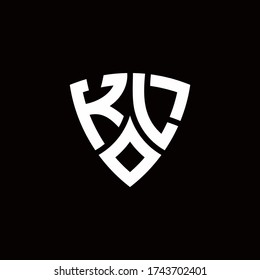 KL monogram logo with modern shield style design template isolated on black background
