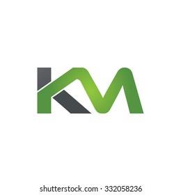 KM company linked letter logo green