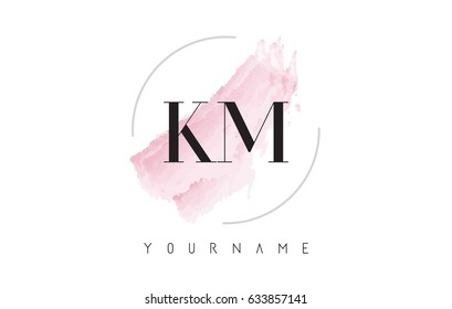 KM K M Watercolor Letter Logo Design with Circular Shape and Pastel Pink Brush.