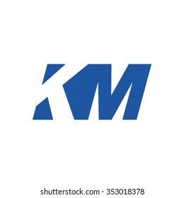 KM negative space letter logo blue
