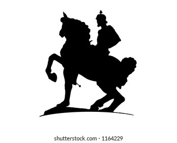 A knight ridding a horse.